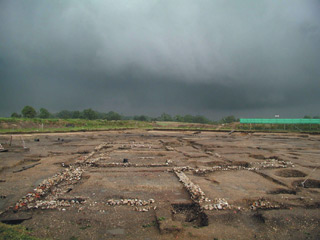 Photo of site under stormy clouds