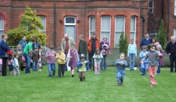 Families take part in an apple and spoon race on Apple Day