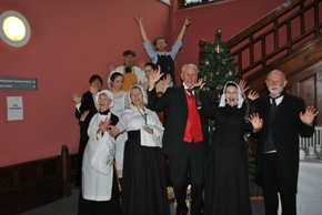 Volunteers in costume for the Victorian Christmas celebration