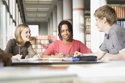 Students studying in the University library
