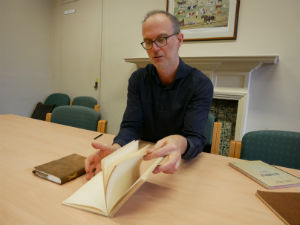 Composer Tim Parkinson studies one of Samuel Beckett's notebooks from the Collection