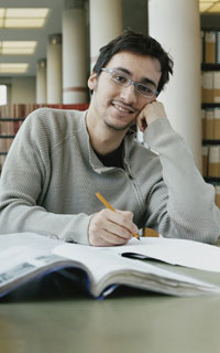 Researcher in the library at the University
