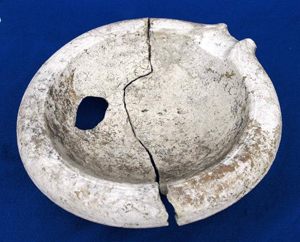A Roman mortarium, used for grinding and mixing foods, found at the Silchester site (Calleva) by archaeologists from the University of Reading