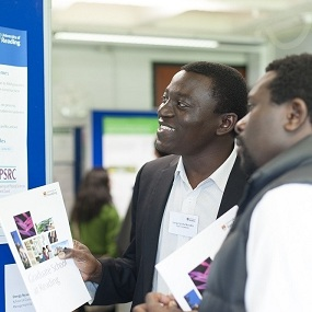 Doctoral Researchers view entries to the Research Poster Competition at the 2013 PhD Research Conference