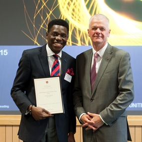 Joint winner of PhD Researcher of the Year 2015, Adeyinka Adewale, with the Vice Chancellor, Sir David Bell