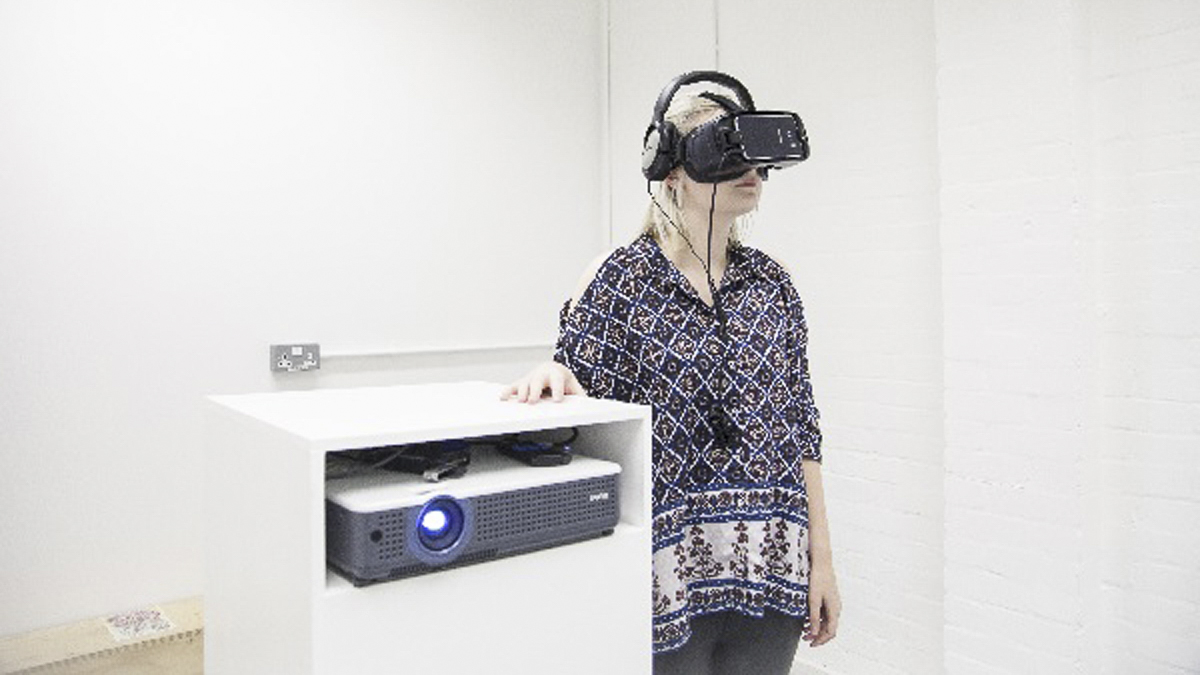 Student, Frances Glazier, uses  a virtual reality headset