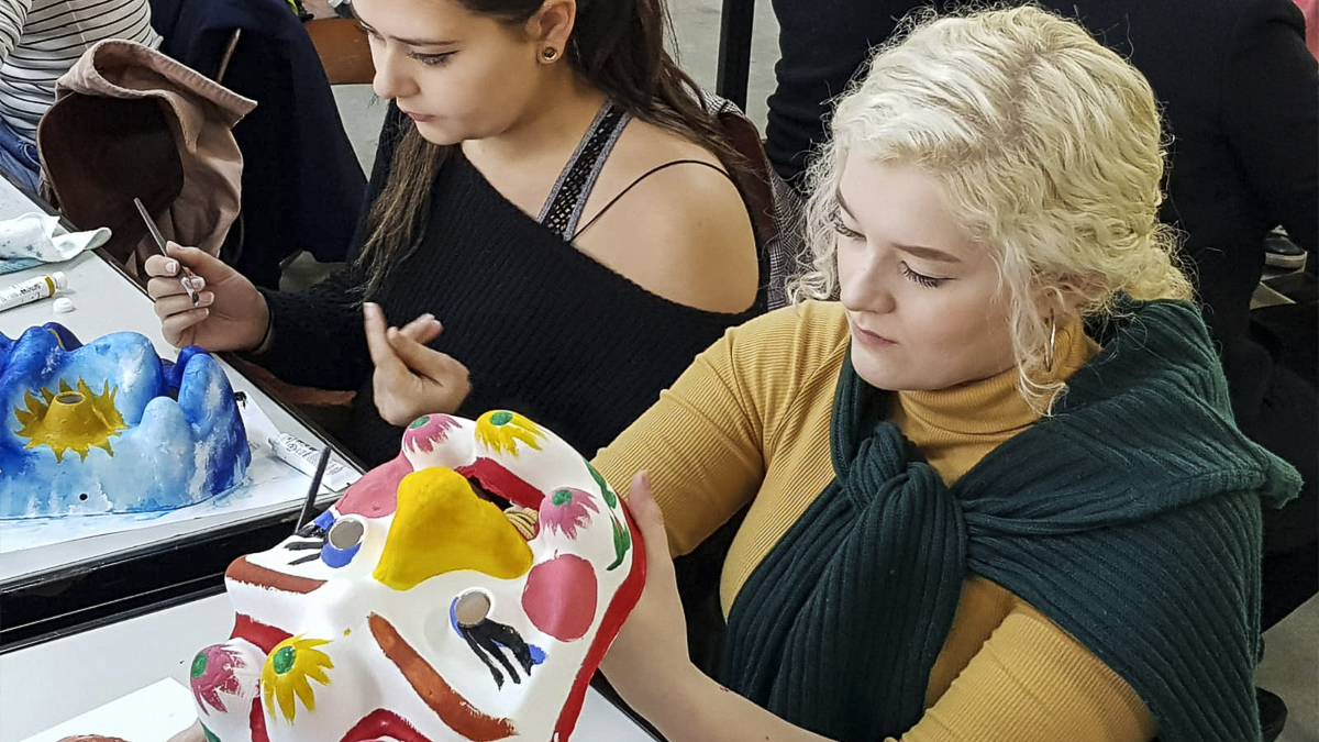 Students painting masks
