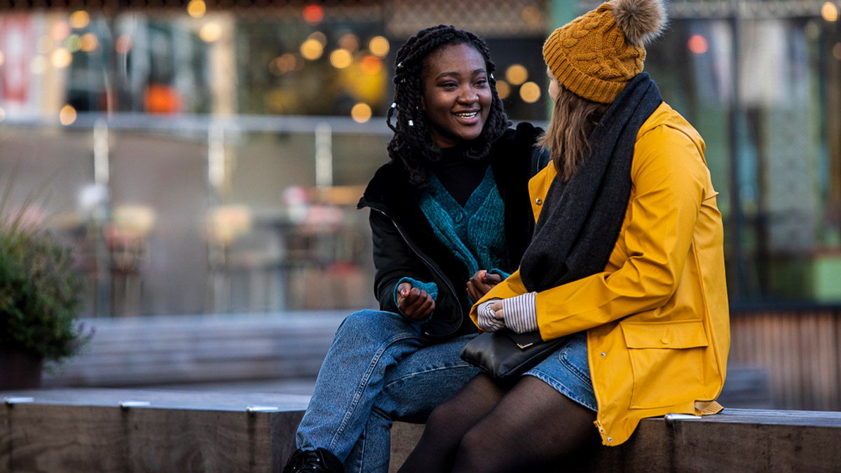 Two students chatting in Reading town centre