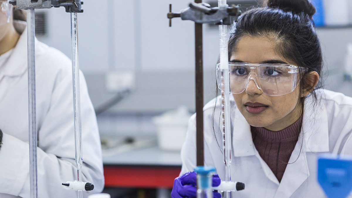 A student measuring the results of an experiment