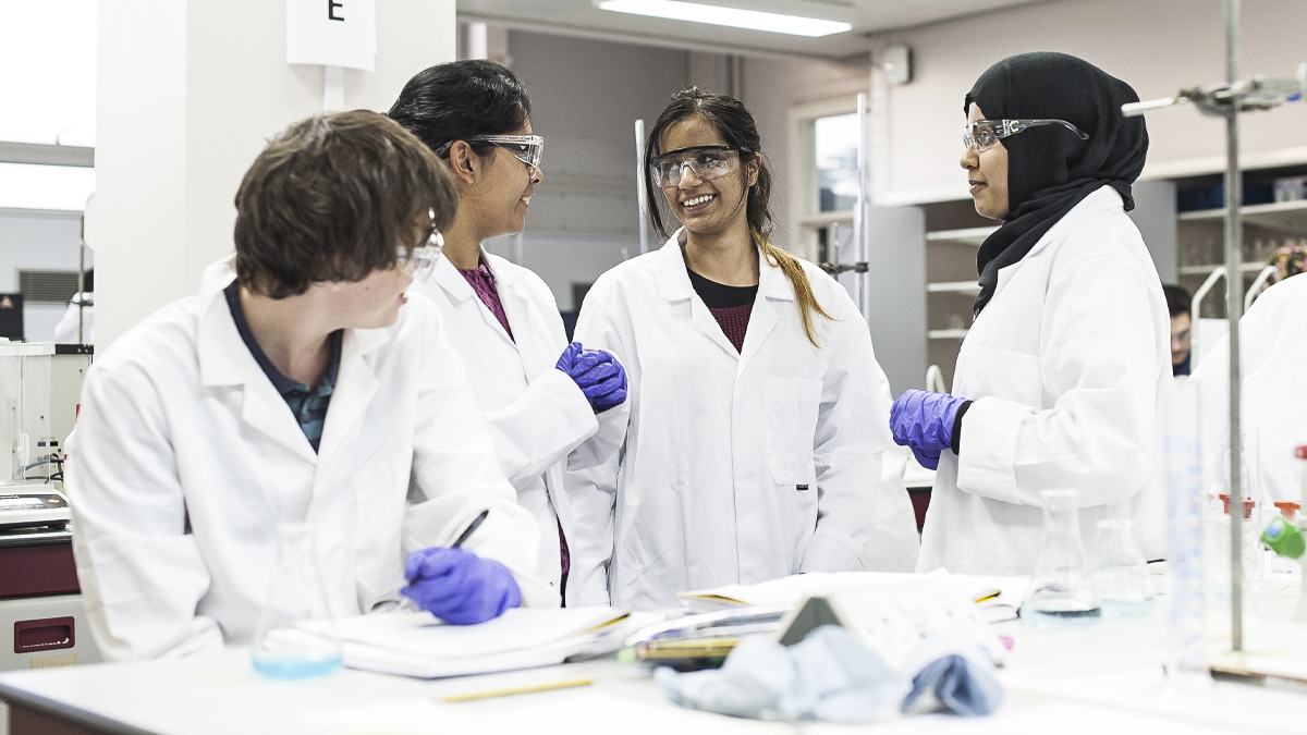 Group of students chatting in a science lab