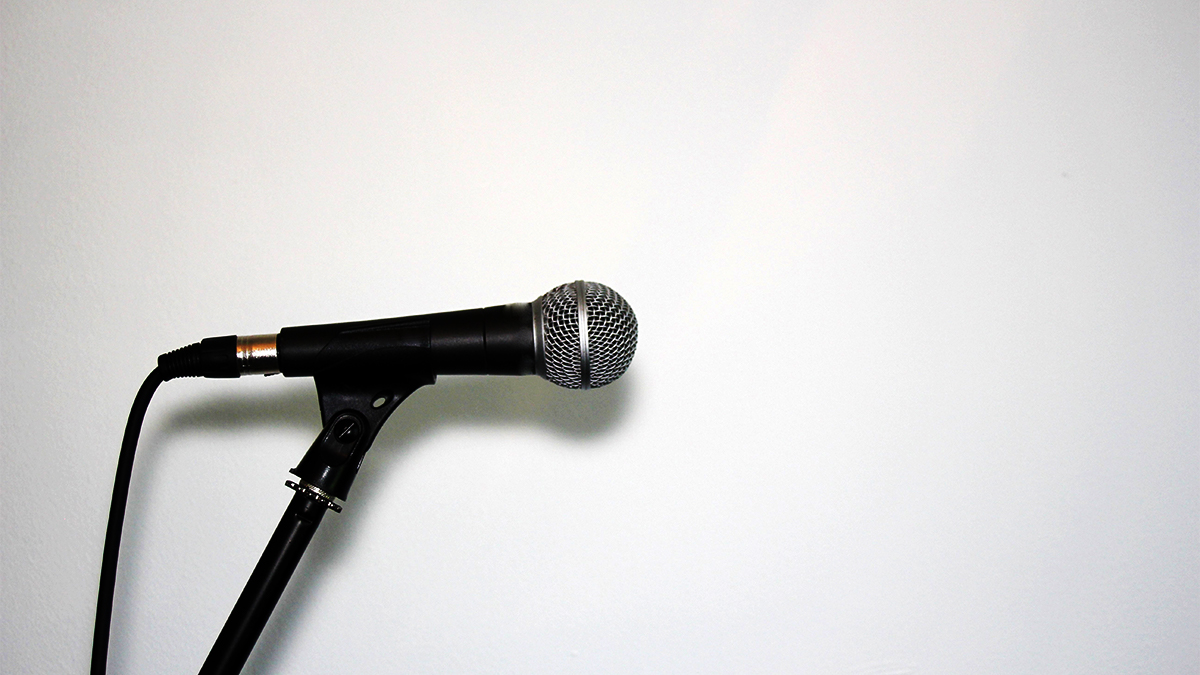 Microphone on a stand against a white background