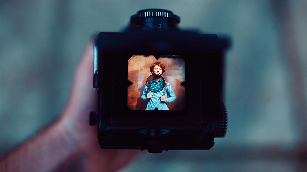 Close up of a camera's viewfinder showing a photograph taken of an actor in costume