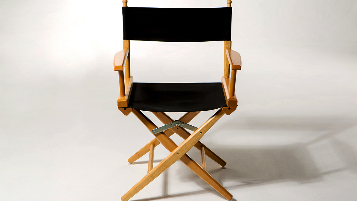 A director's chair against a white backdrop