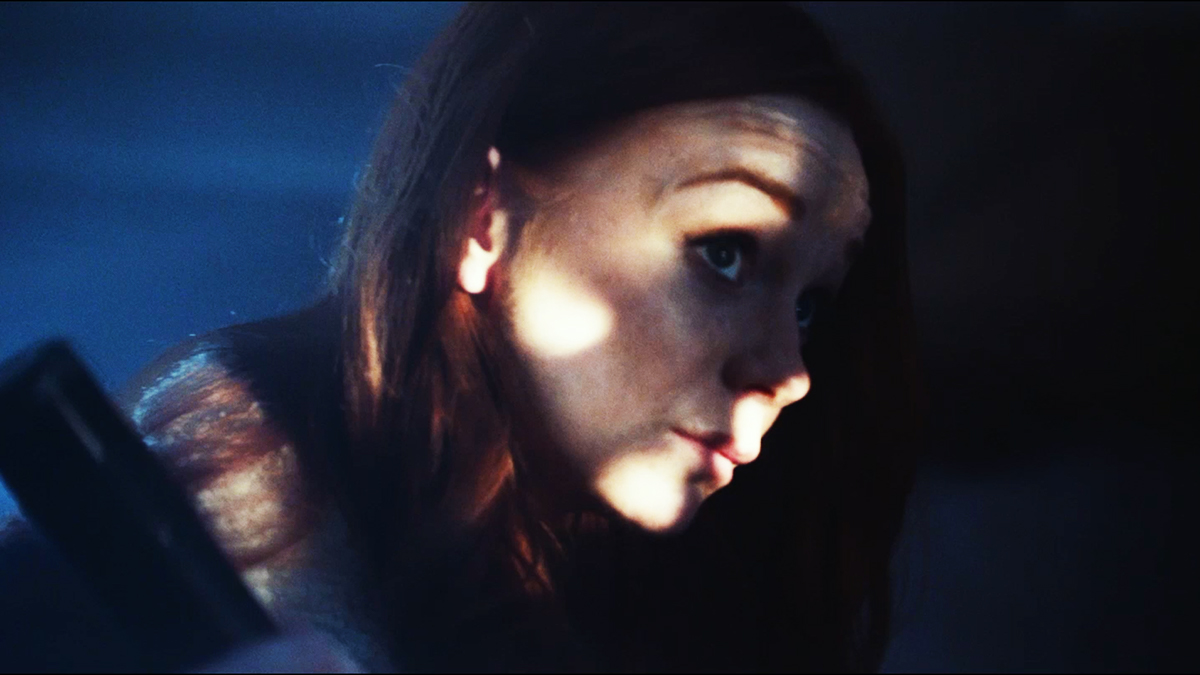 Screenshot of a student film, of a face with light