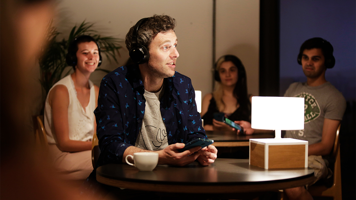 Man wearing headphones acting in User Not Found project performance