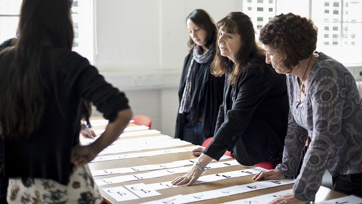 Professor teaching workshop on letterforms in Department of Typography