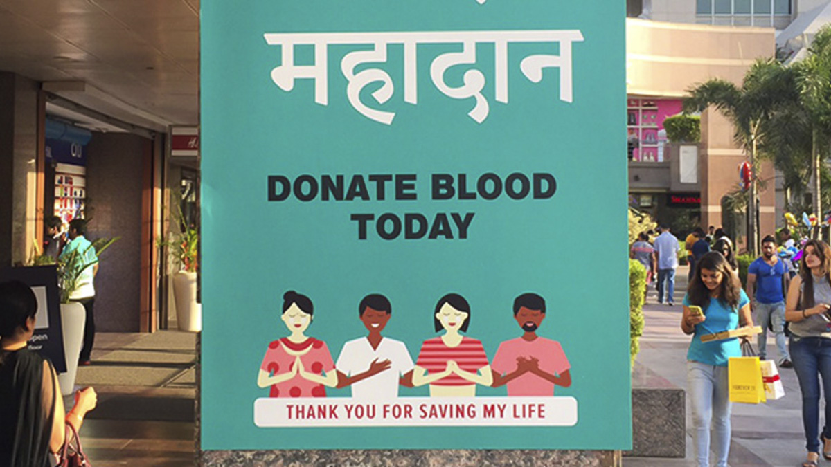 Blood donation poster for India with Bengali-script typeface designed by Professor Fiona Ross