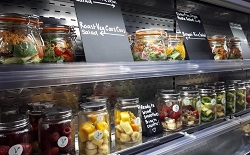 Salads and snacks on two shelves of Dol.che Vita cafe
