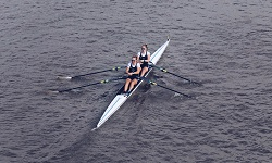 Colour photograph of University of reading rowers takign part in race on river thames