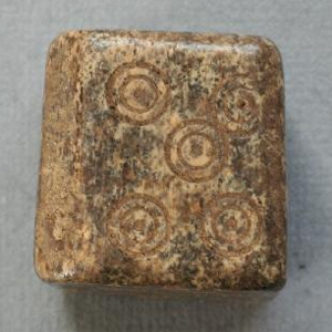 A bone die discovered at Silchester - University of Reading