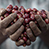 Hands clasping Fairtrade coffee beans
